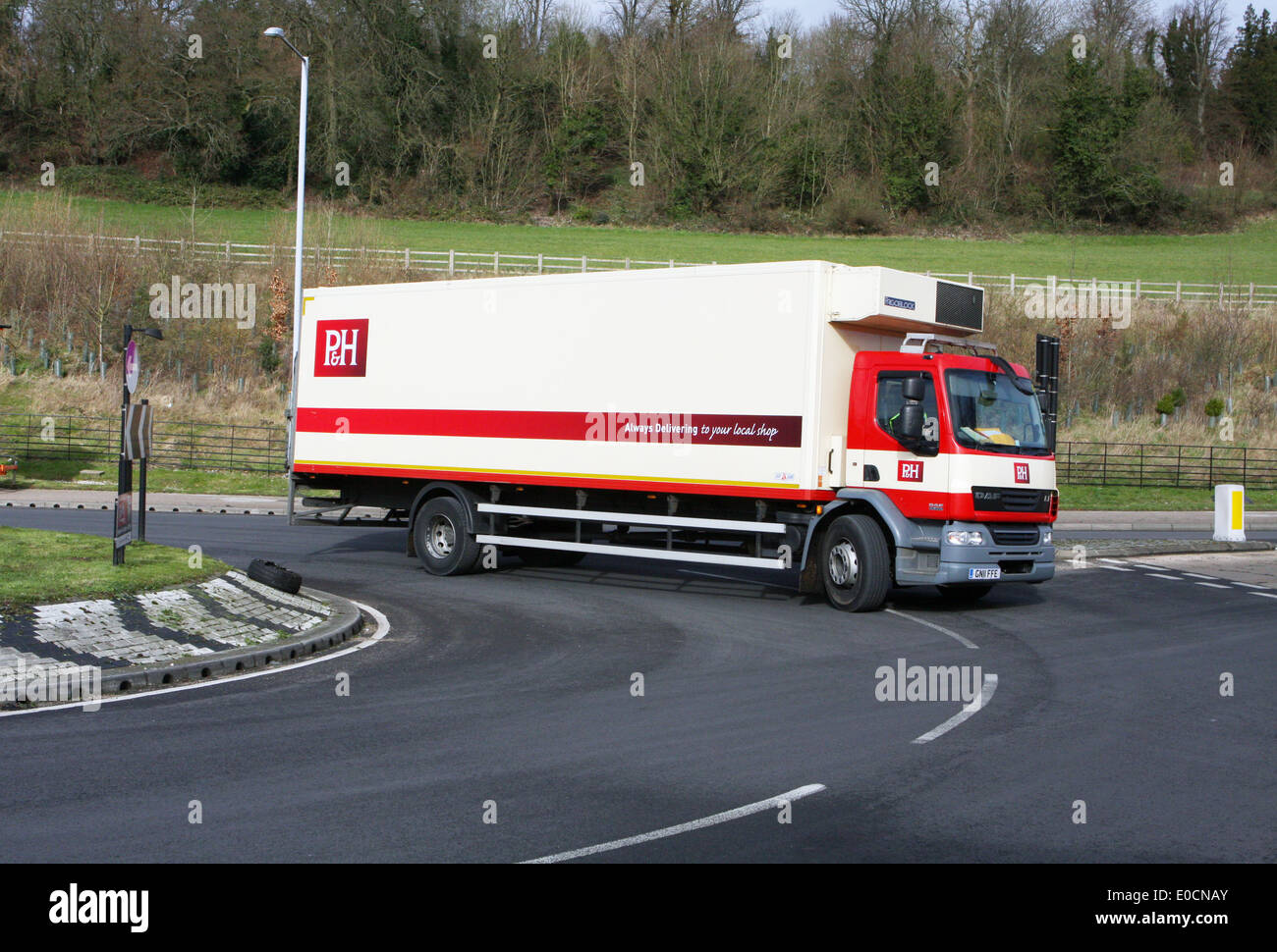 A palmer and harvey truck traveling around a roundabout in coulsdon surrey england