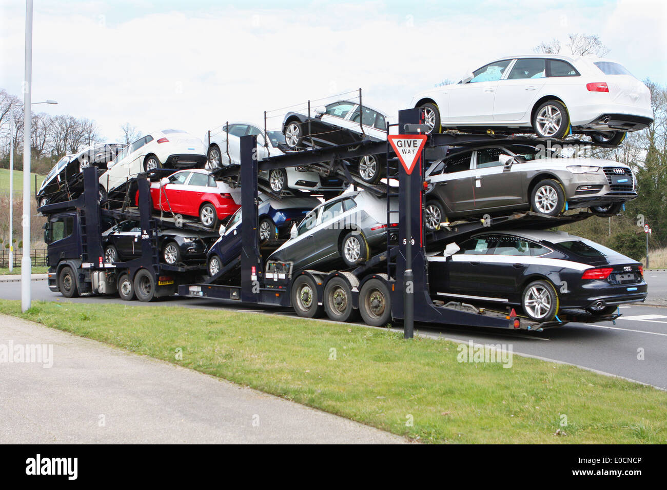 A Car Transporter Carrying A Load Of New Audi Cars And