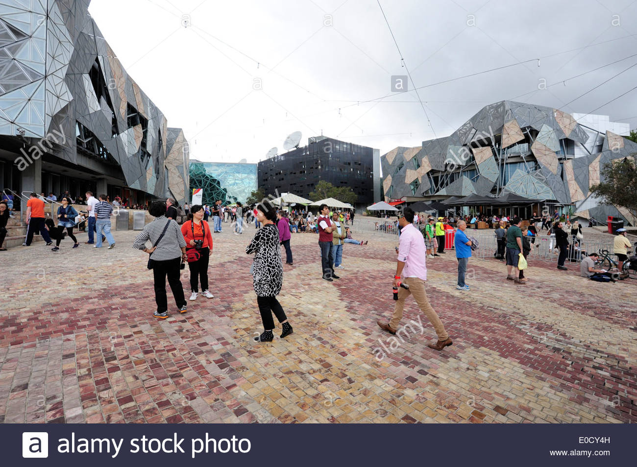 Modern Architecture Melbourne tourists at federation square, a cultural centre, modern