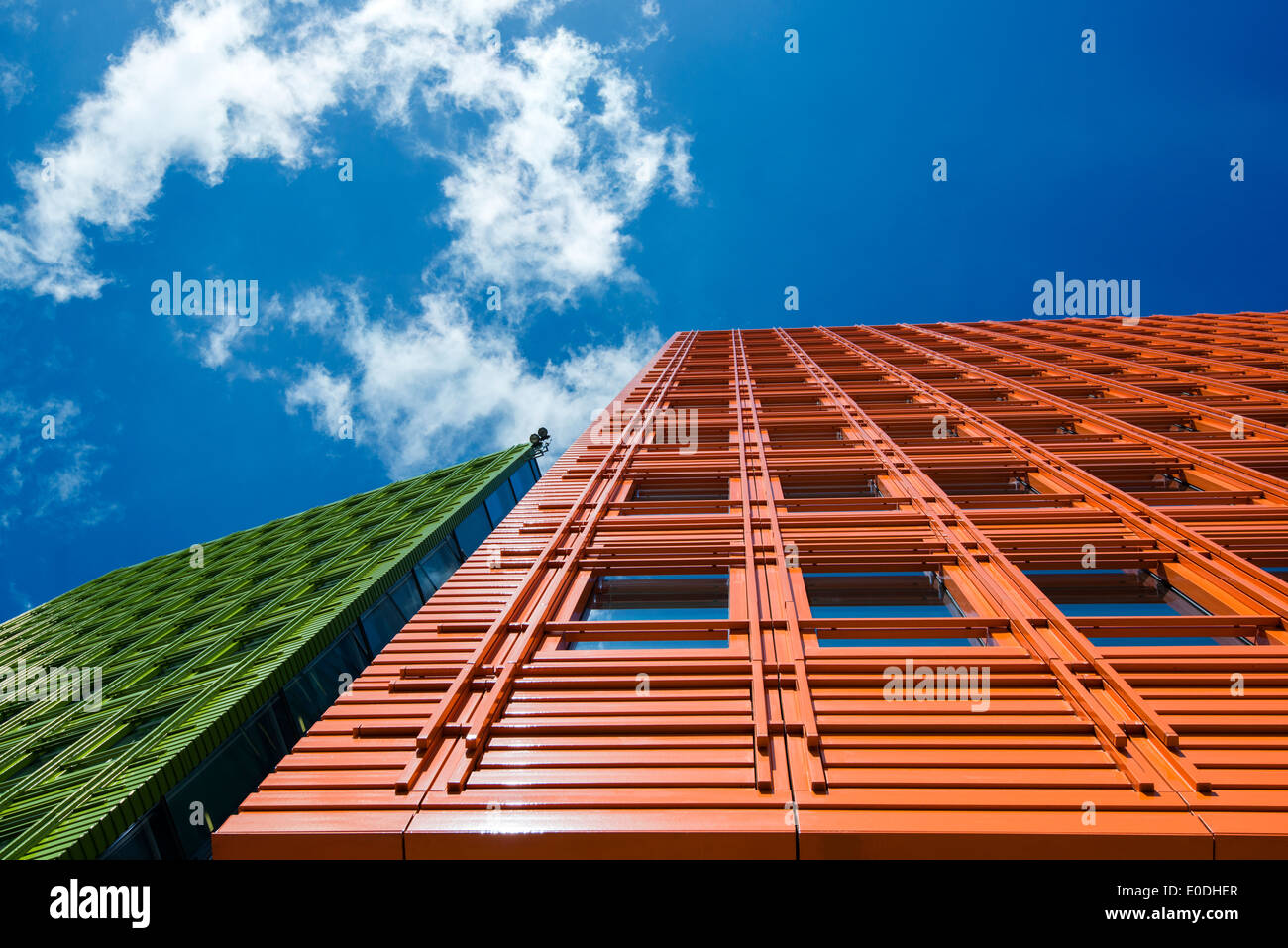 bright orange and green facade on an office building in central saint giles in london england uk brightly colored offices central st