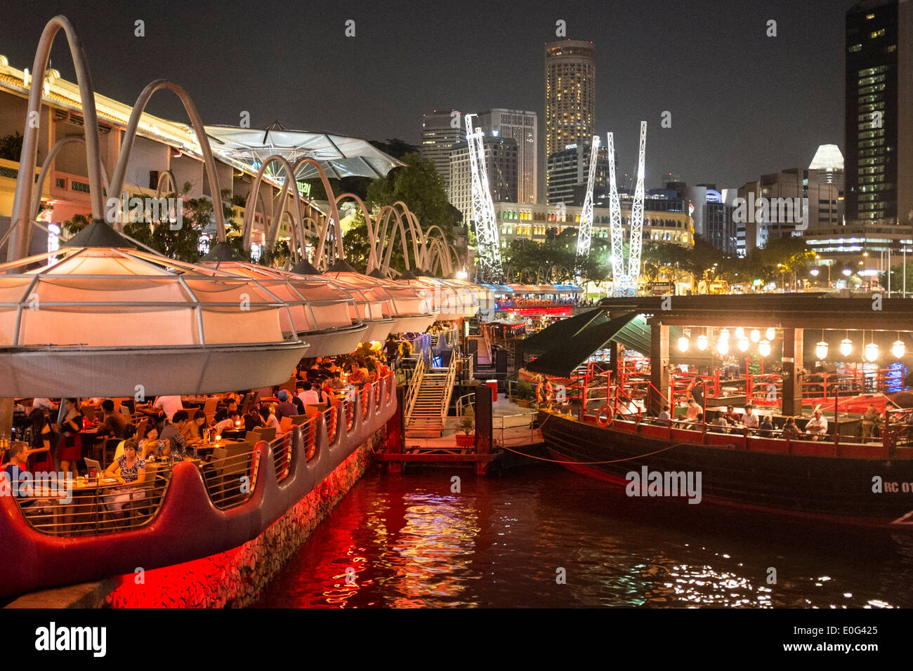 Patrons Dine On The River At Clarke Quay In Singapore