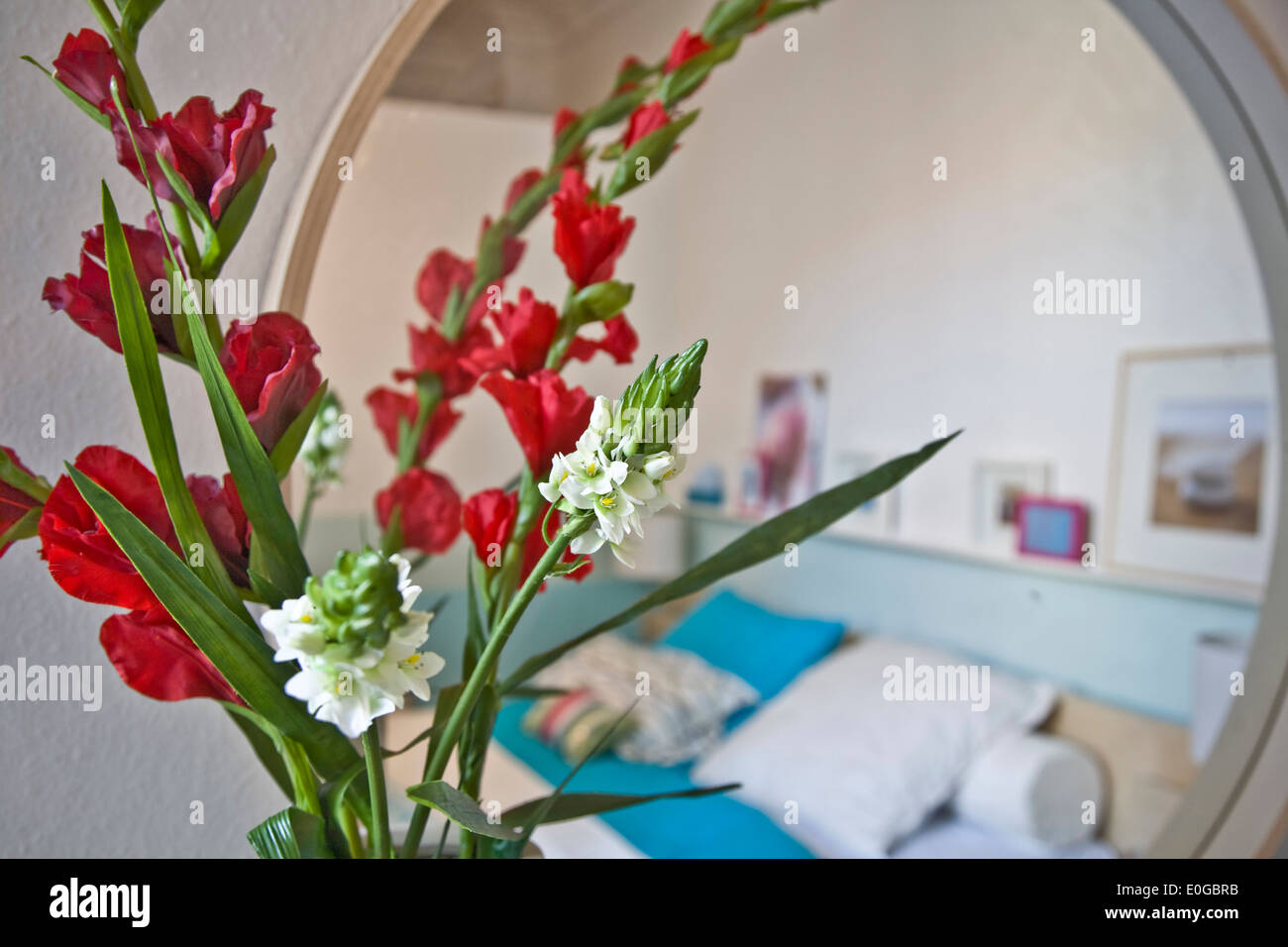 Mirror In The Bedroom Bunch Of Flowers In Front Of A Mirror In A Bedroom Stock Photo
