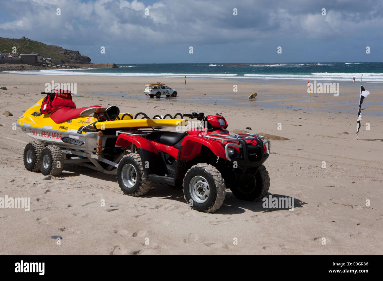 an rnli lifeguard 39 s quad bike and jet ski pwc rescue craft and a stock photo royalty free image. Black Bedroom Furniture Sets. Home Design Ideas