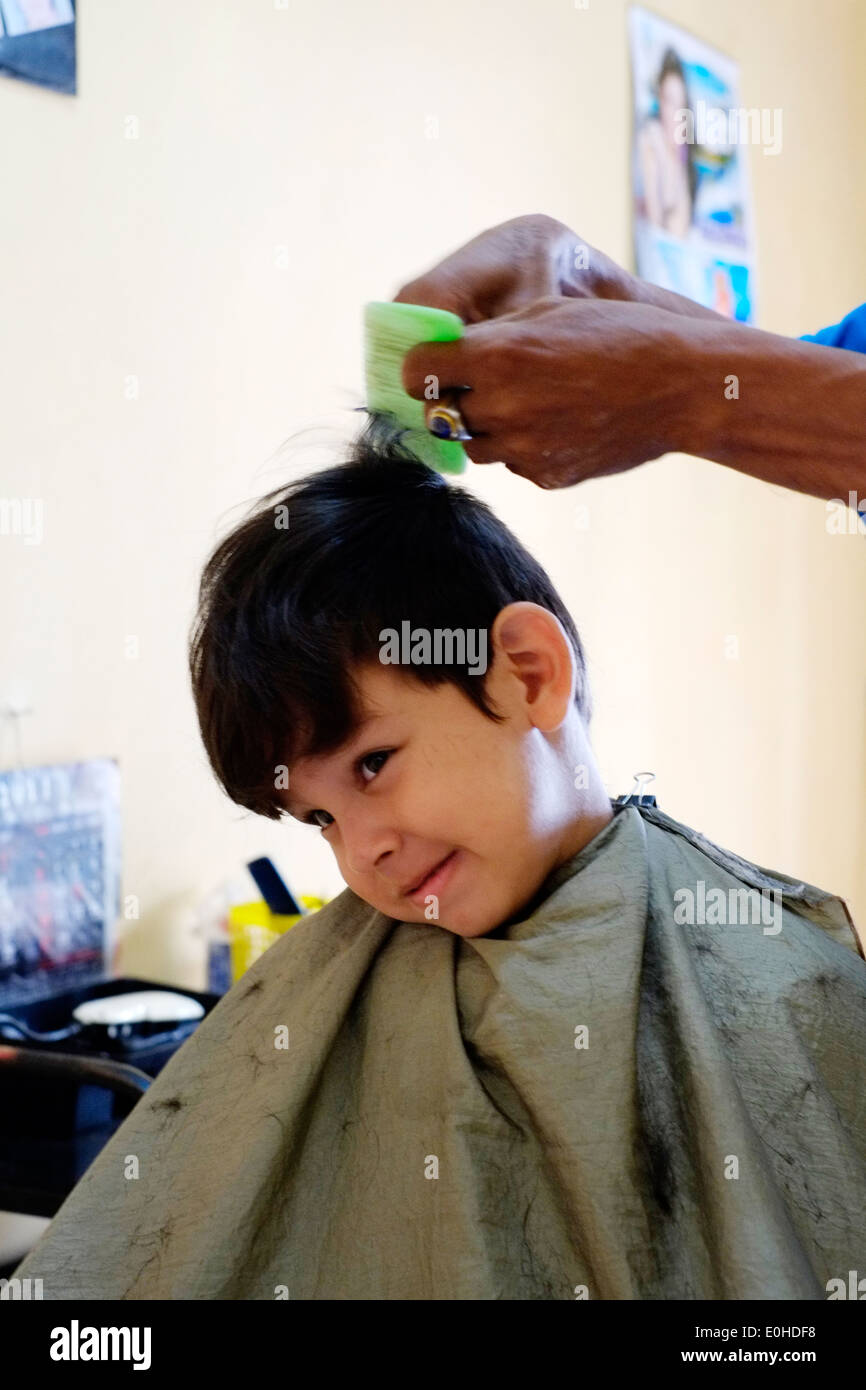 Little Boy Having A Haircut In A Small Village Home Salon In East - Hairstyle barbershop indonesia