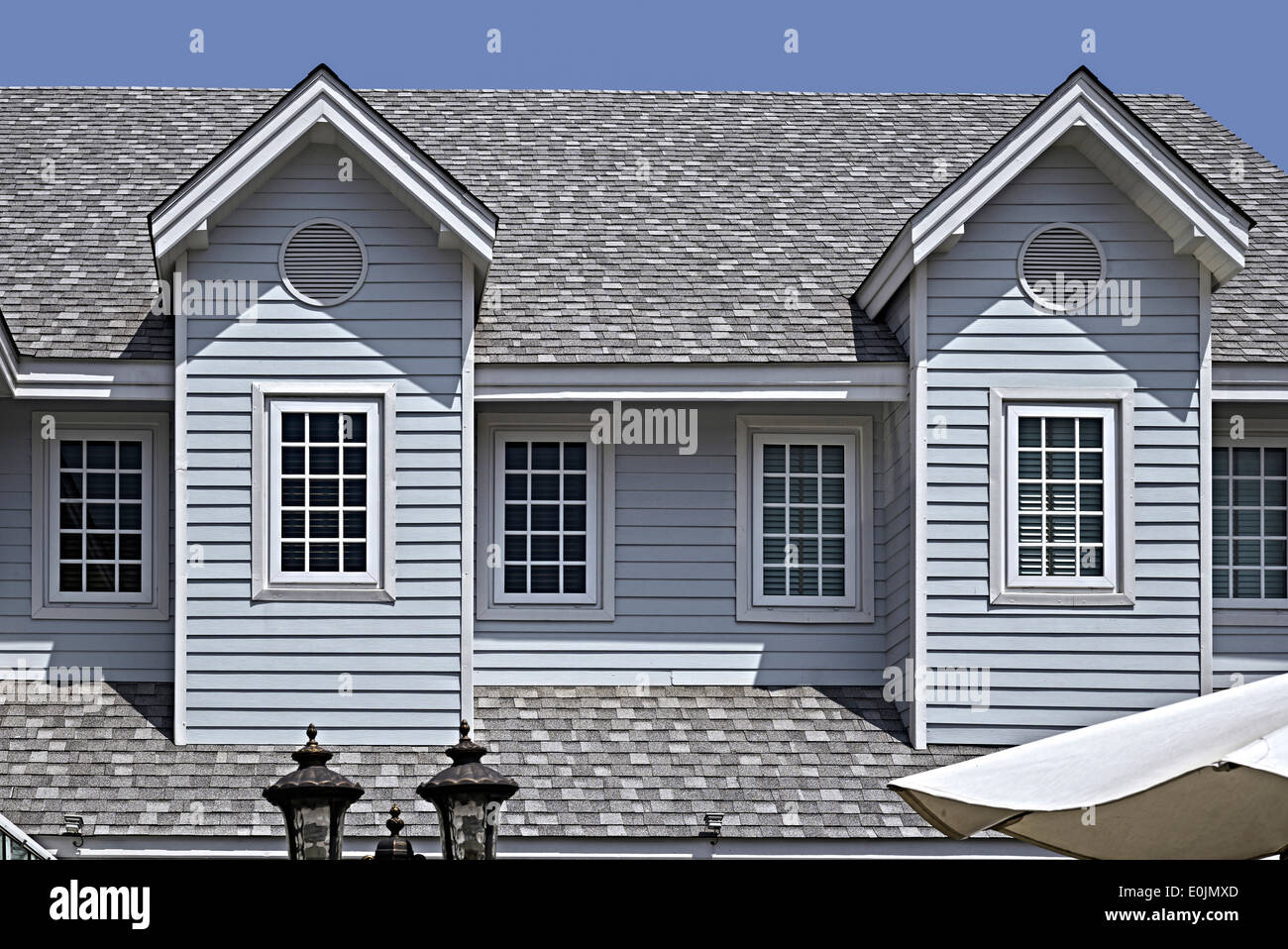 Large Dormer Window And Shingled Roof Construction With
