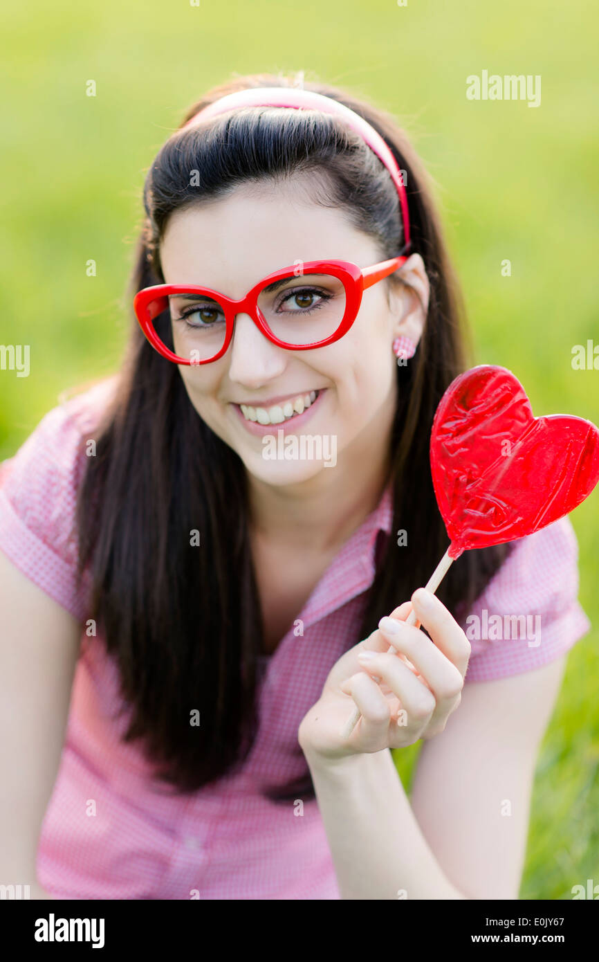 lolly model Woman With Heart Lolly, (model Release Stock Photo, Royalty Free .