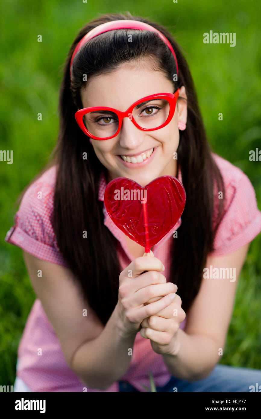 lolly model Stock Photo - woman with heart lolly, (Model release