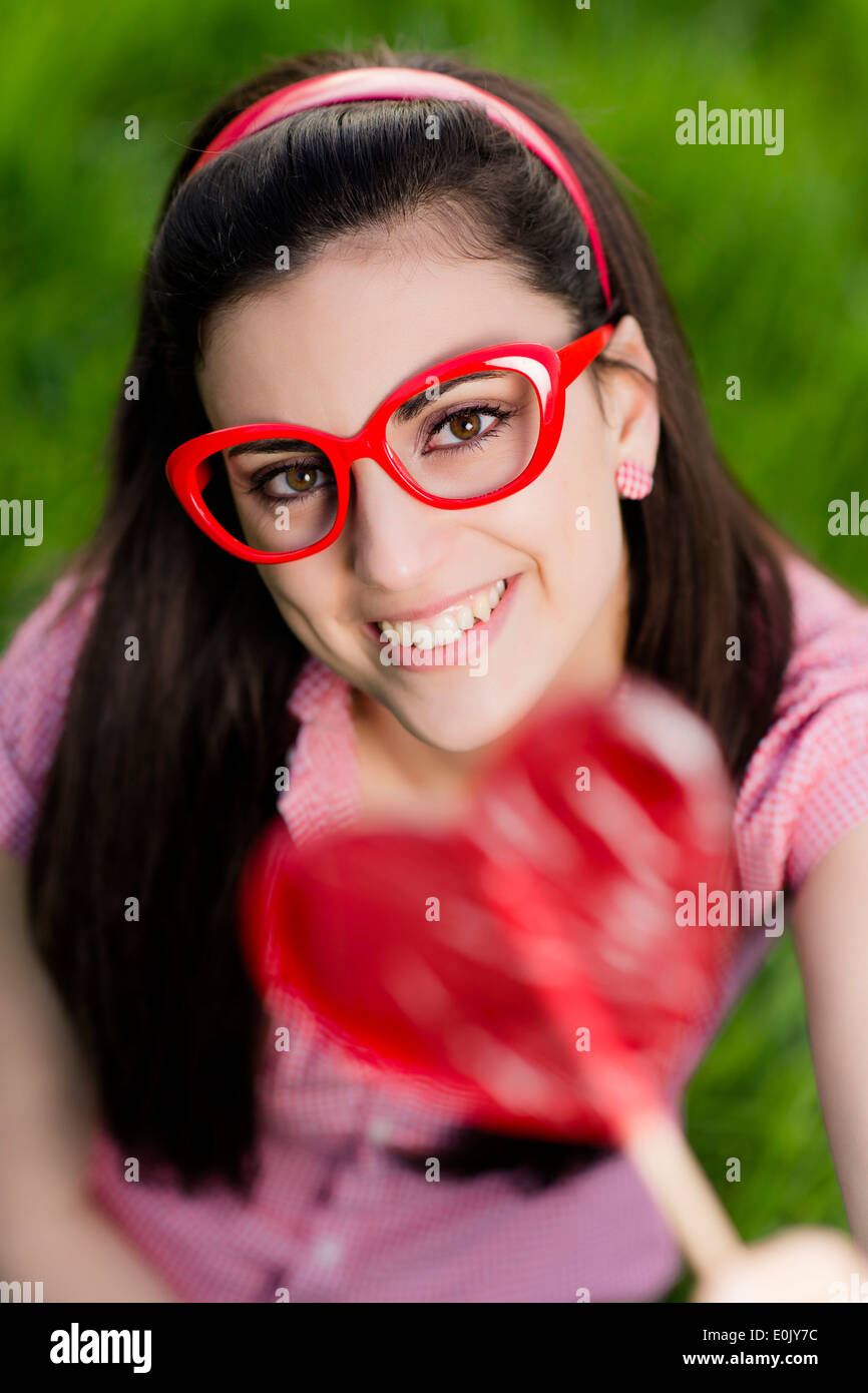 lolly model ... woman with heart lolly, (Model release) - Stock Photo
