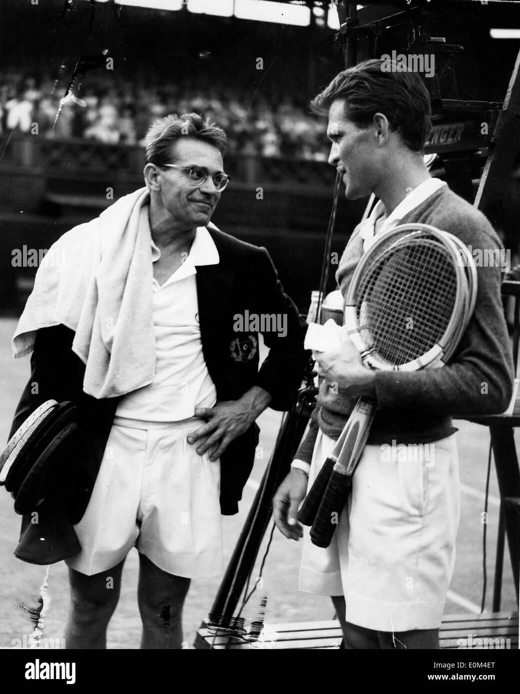 Tennis Stars Jaroslav Drobny and Budge Patty talking at Wimbledon