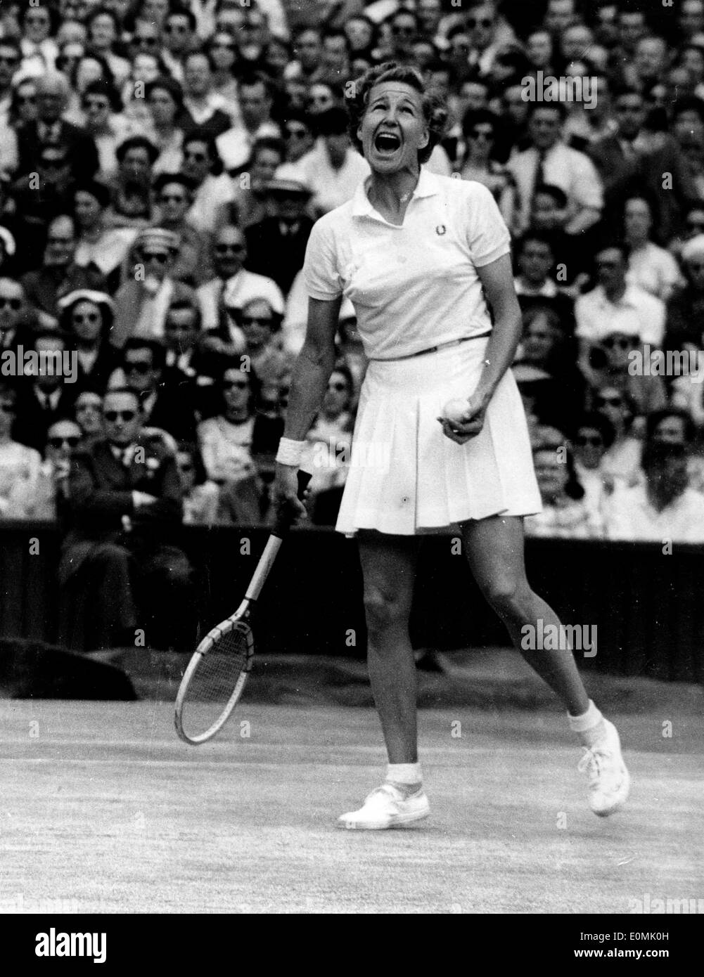 Tennis Champ Louise Brough during a match at Wimbledon Stock