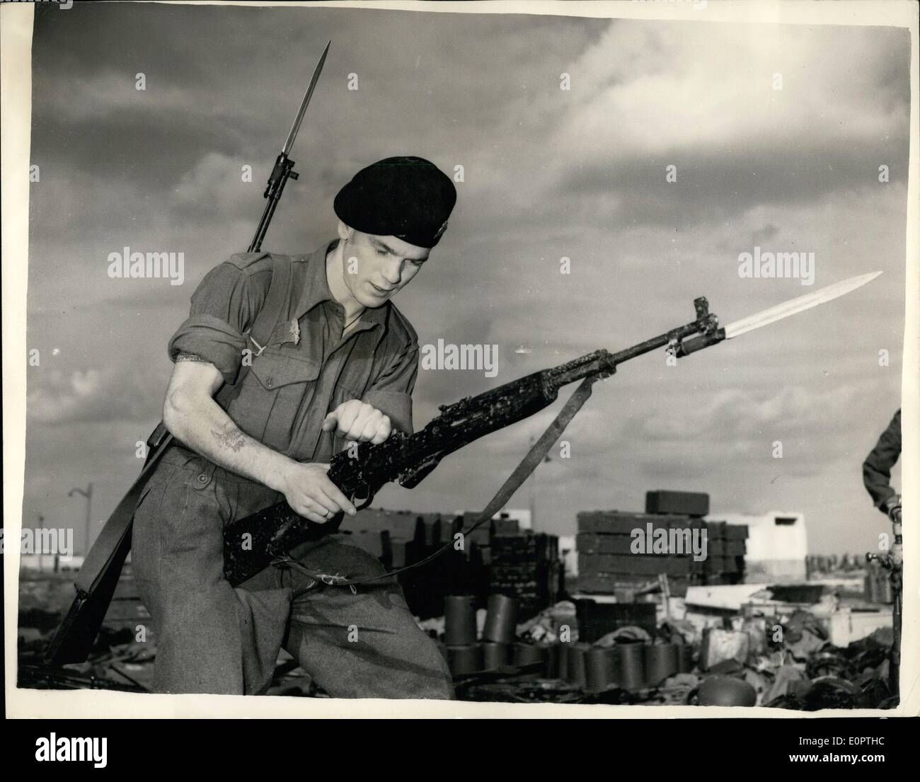 pthc russian 12, 1956 - Latest Scenes From Port Said Captured Russian 270 Rifle; Photo Shows Roger Rainbird from Hornsey, London look's