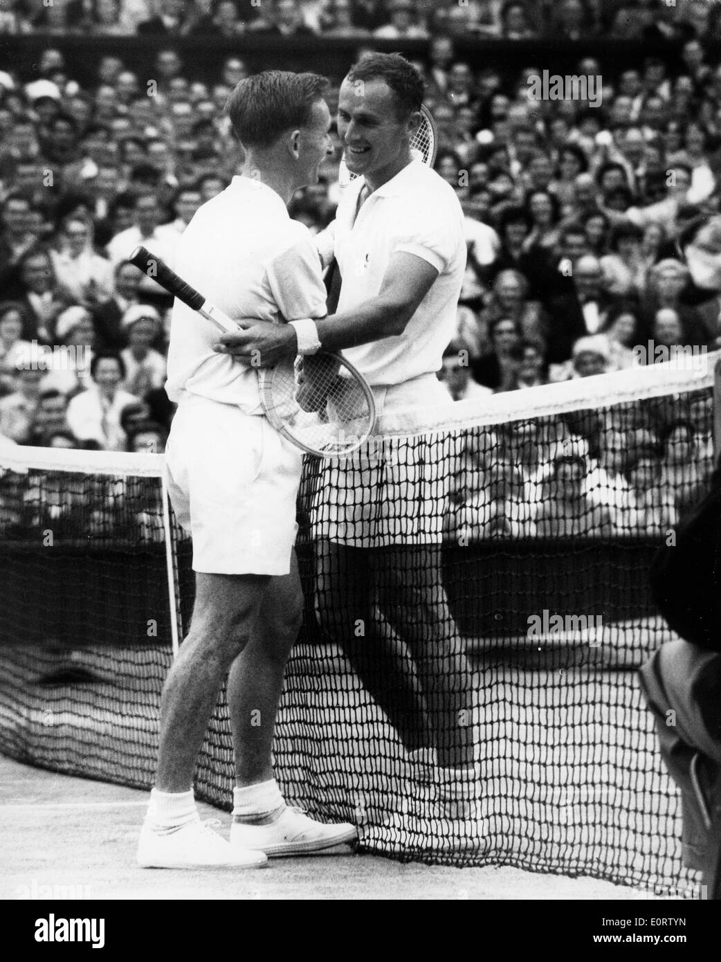 Tennis pro Neale Fraser greets opponent at match Stock