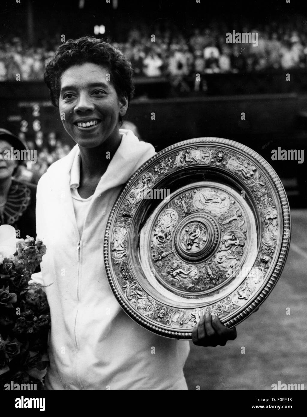 Tennis pro Althea Gibson shows off Wimbledon trophy Stock