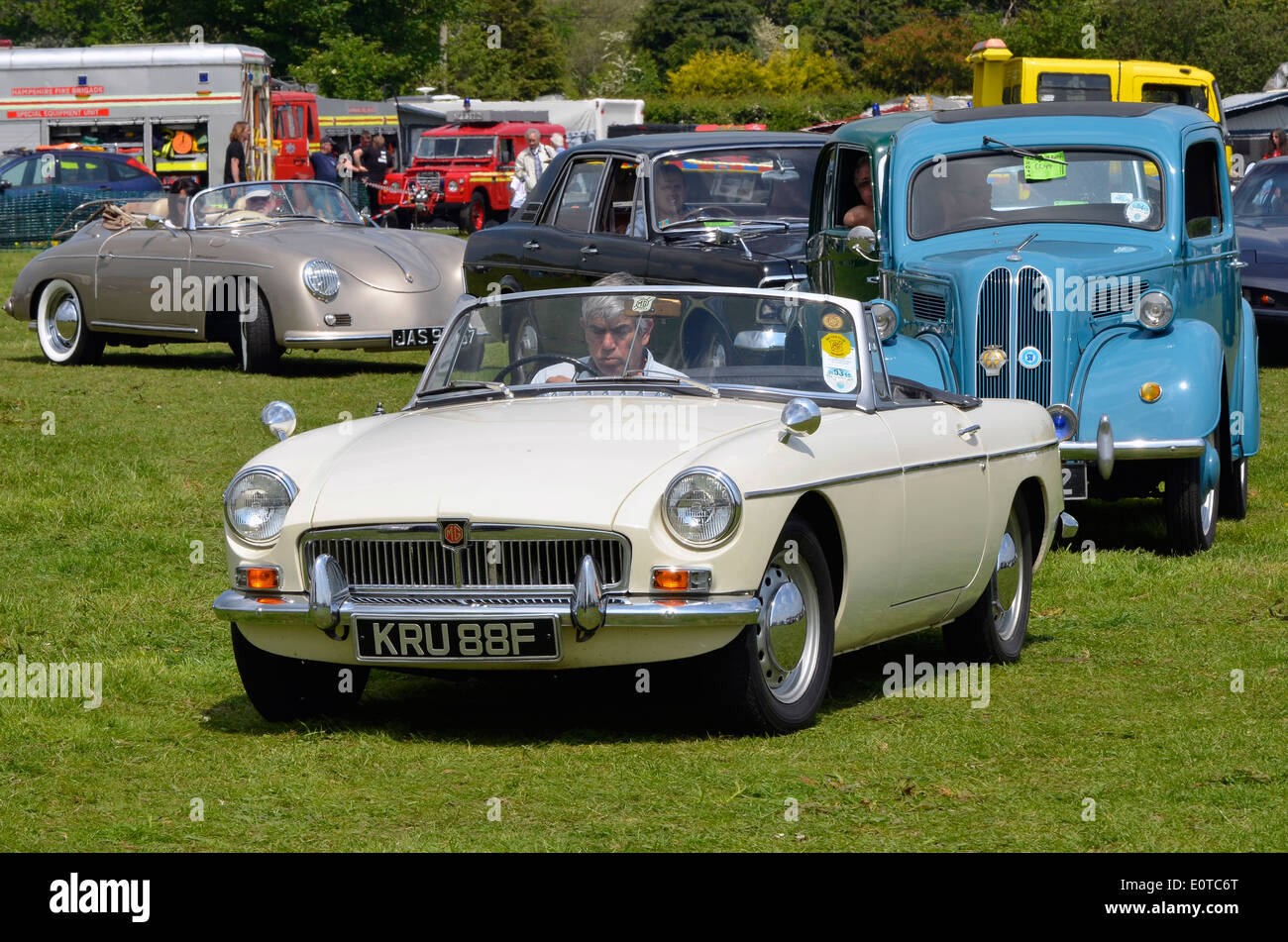 Classic cars line up for the parade ring at a classic vehicle show - 1967 MGB Ford Popular Ford Cortina Mk2 and early Porsche. & Classic cars line up for the parade ring at a classic vehicle show ... markmcfarlin.com
