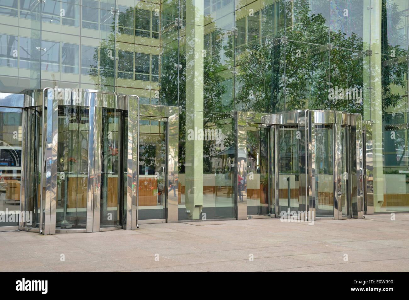 Entrance to modern office block via glass revolving doors stock entrance to modern office block via glass revolving doors planetlyrics Image collections