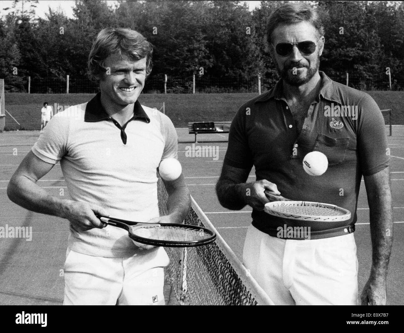 Actor Charlton Heston playing tennis with Sepp Maier Stock