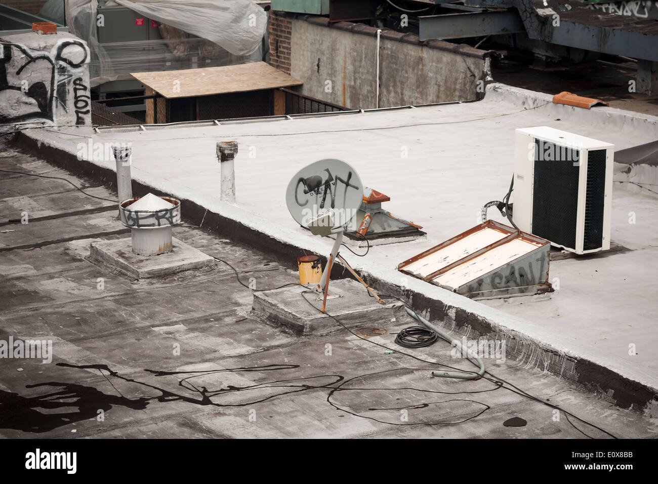 DirecTV satellite dish on the roof of a building in the New York – Satellite Dish Technician