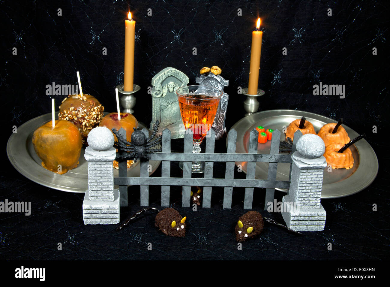 Halloween buffet table - Halloween Buffet Table Decorated As A Grave With Caramel Apples Pumpkin Cakes And Candies