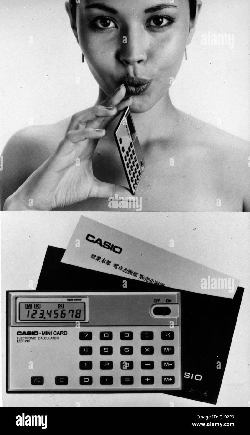 Model displays slim business card sized Casio calculator designed to ...