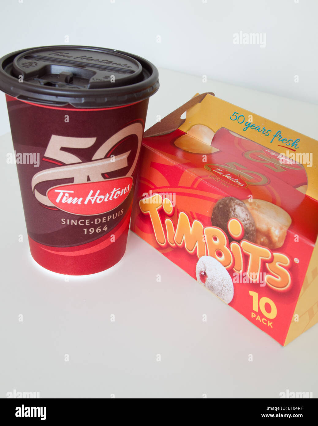 Tim Hortons Coffee Maker Manual : A Tim Hortons coffee cup and Timbits (doughnut holes, donut holes Stock Photo, Royalty Free ...