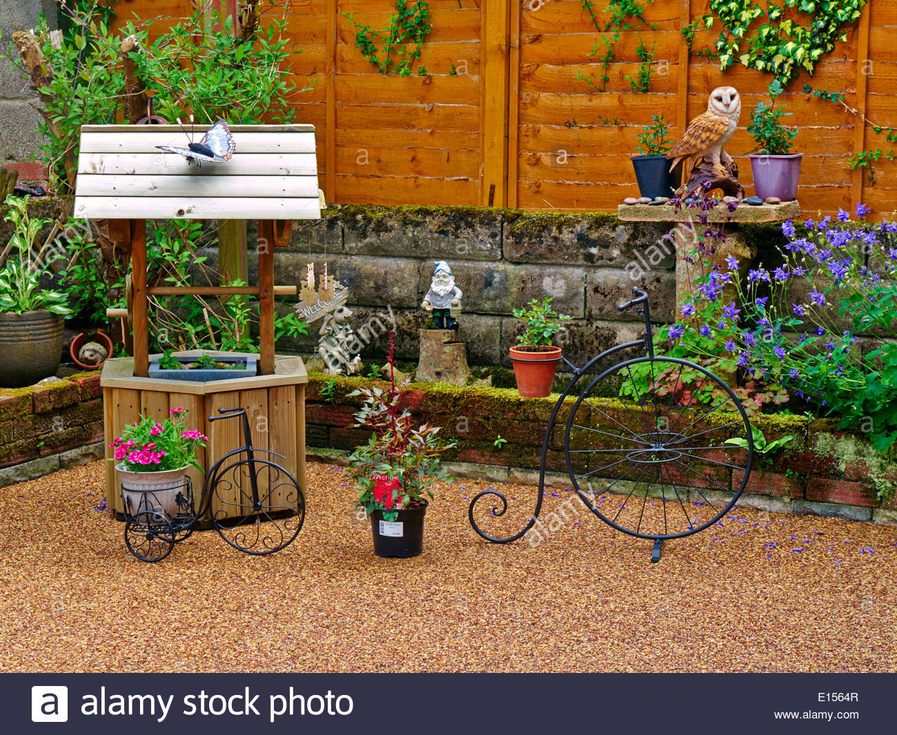 Decorative garden ornaments - A Patio Backyard Filled With Decorative Garden Ornaments And Potted Plants Stock Image