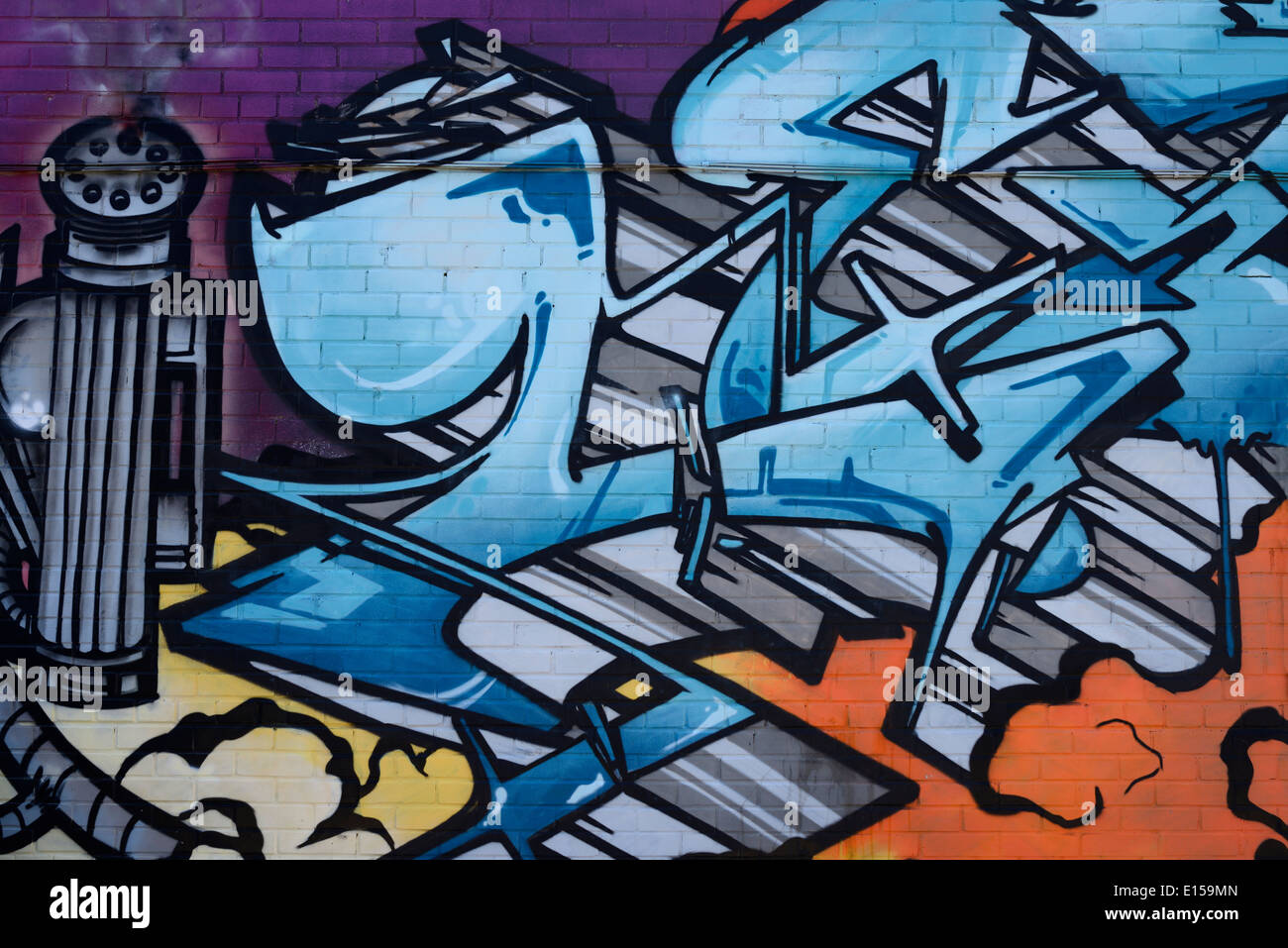 Futuristic Spray Paint Graffiti Tag With Machine Gun On Brick Wall In Stock Photo Royalty Free
