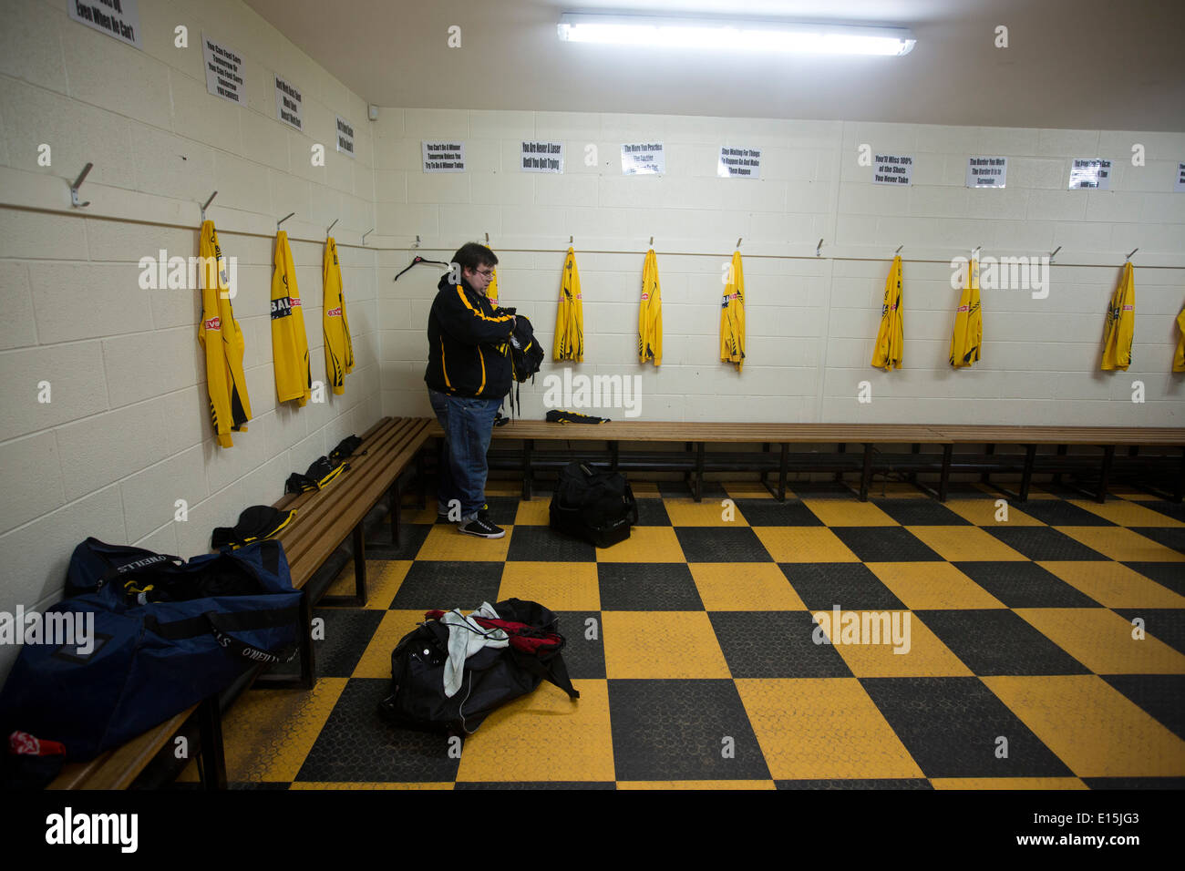 Laying Out A Room the home club's kit man laying out strips in the dressing room