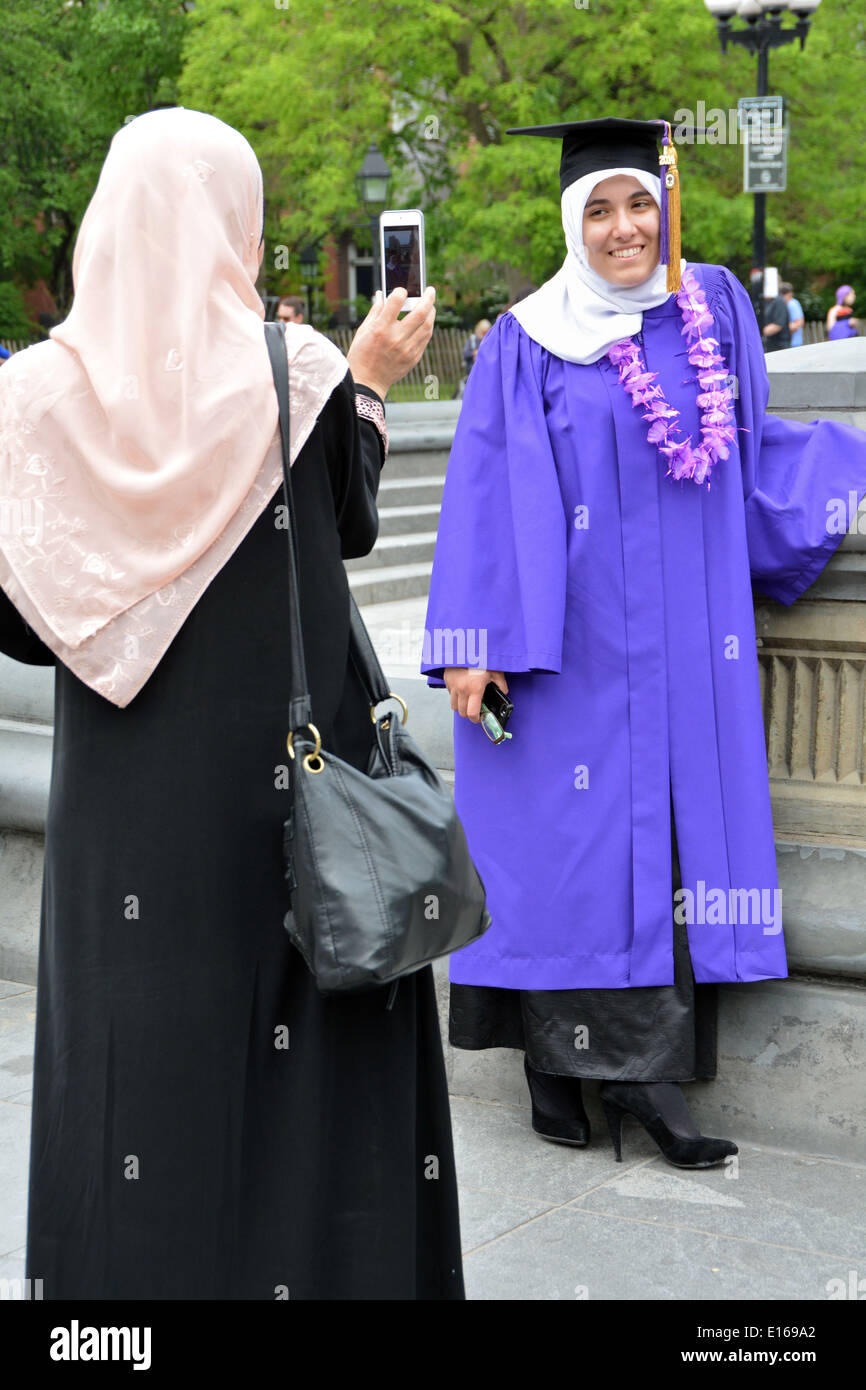 An Arabic Muslim student in cap & gown and her mother celebrating ...