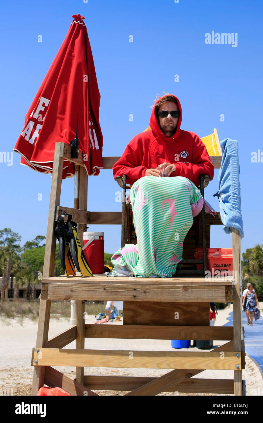 Beach Lifeguard wrapped up against the cold winds blowing ...