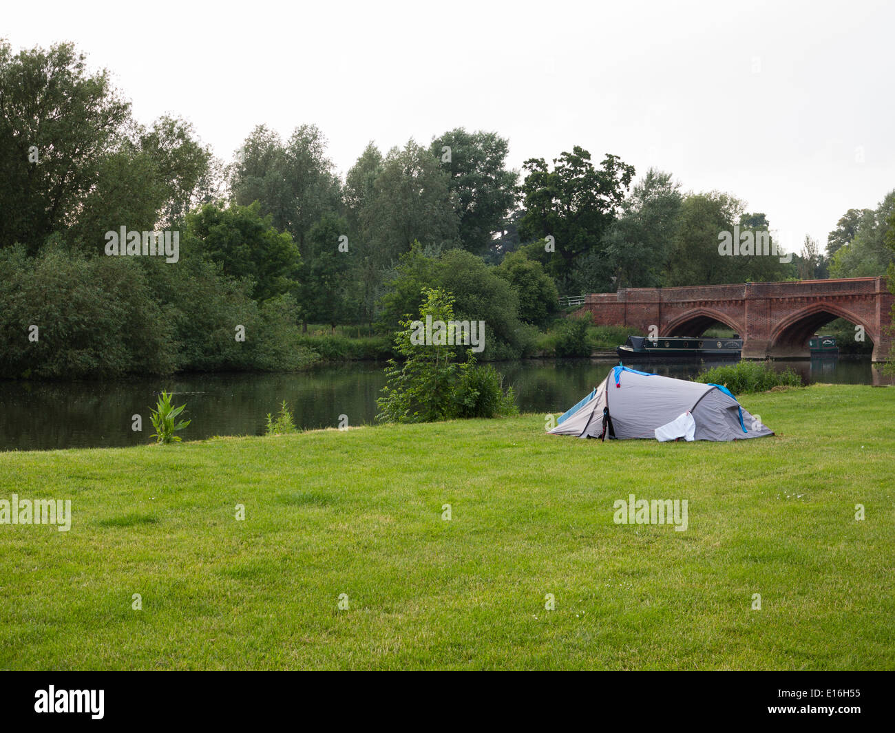 A tent pitched up in a field near Clifton H&den bridge on the bank of the river Thames in Oxfordshire & A tent pitched up in a field near Clifton Hampden bridge on the ...