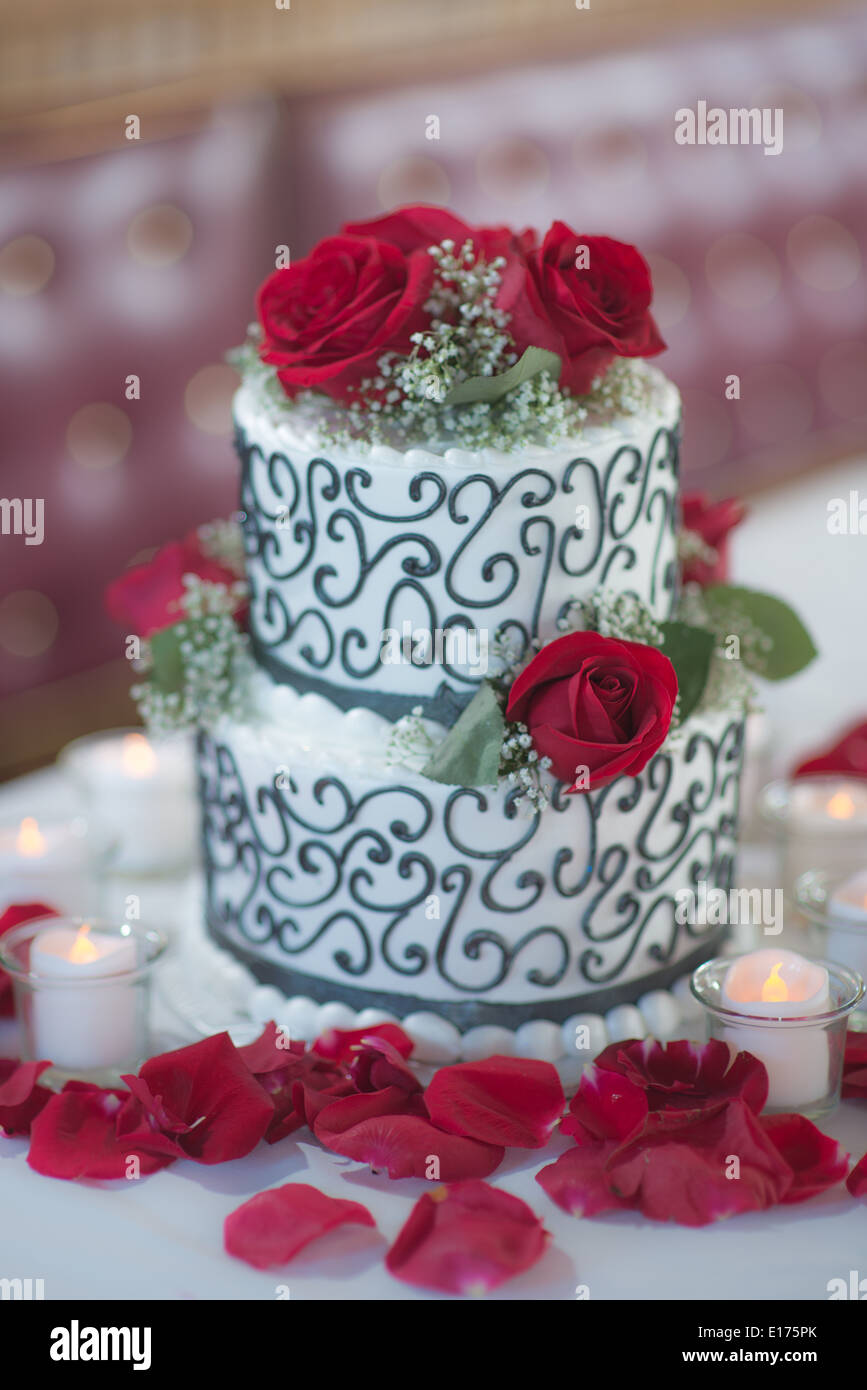 2 Layer wedding cake with a black and white design . The cake is ...