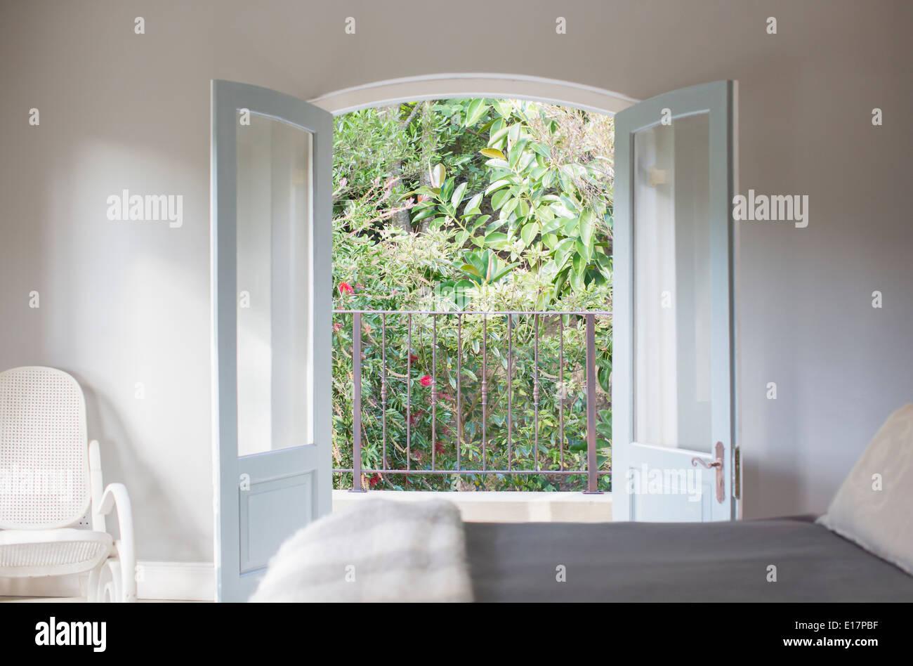 French doors open to balcony in luxury bedroom Stock Photo ...