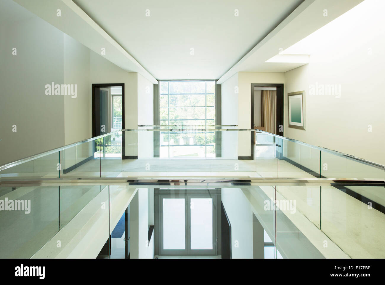 Modern balcony and open foyer in luxury home stock photo for Open balcony