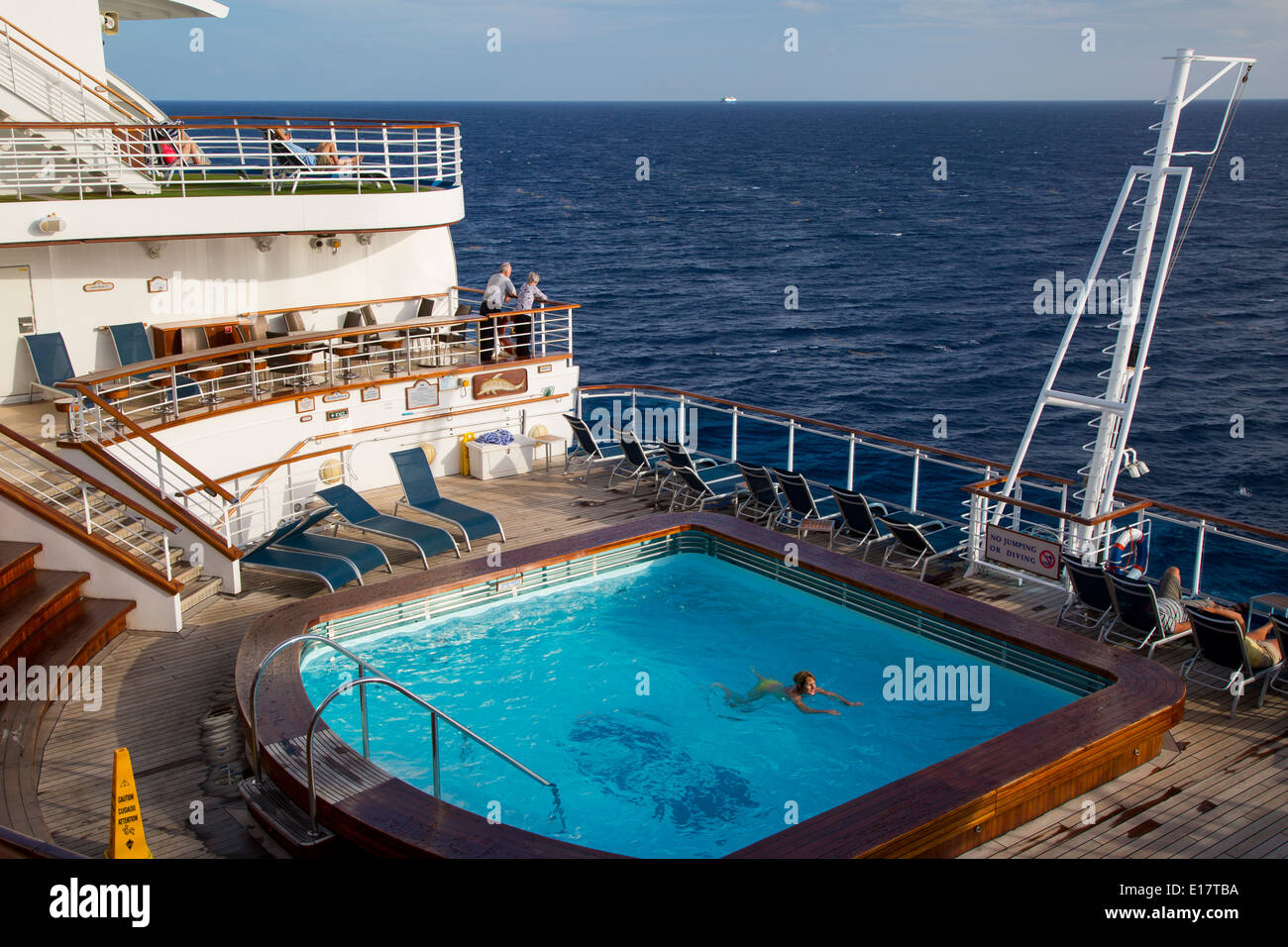 Woman swimming in aft pool of the emerald of the seas cruise ship stock photo royalty free for River cruise ships with swimming pool