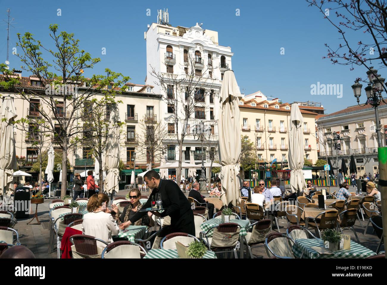 Outdoor restaurant tables at Plaza Santa Ana, Barrio de ...