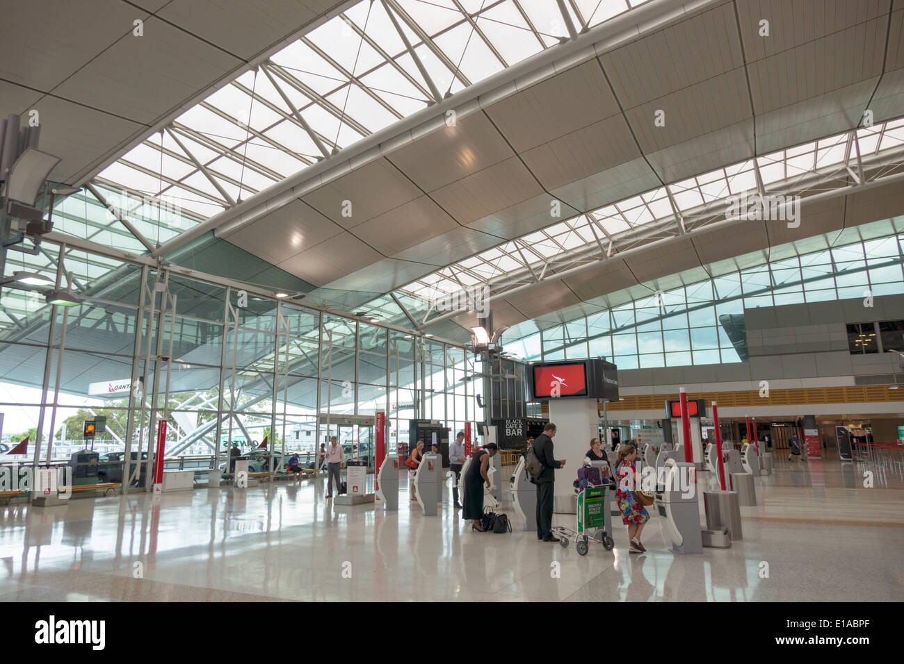 Stock photo sydney australia nsw new south wales kingsford smith airport syd terminal concourse inside interior design architectural self service kiosks