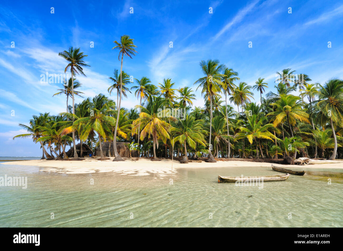 Deserted Tropical Island: Dugout Boats, Deserted Beach With Palm Trees On A Tropical