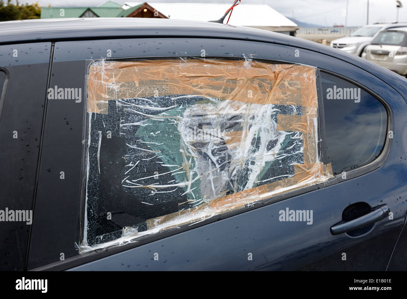 Smashed Broken Rear Car Door Window Taped Up As A