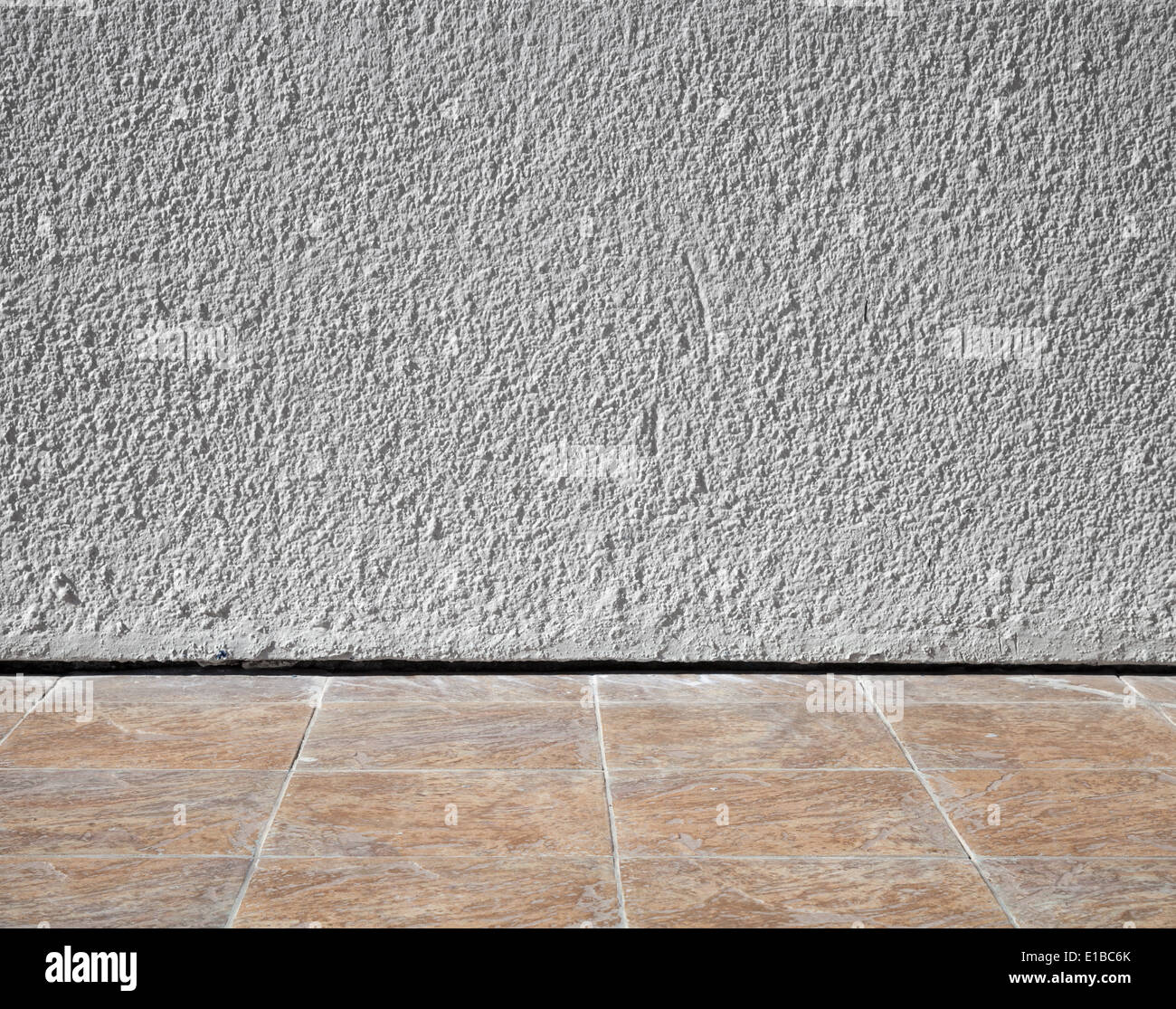 Wonderful Abstract Interior Background With Rough Stucco Wall And Tiling Floor