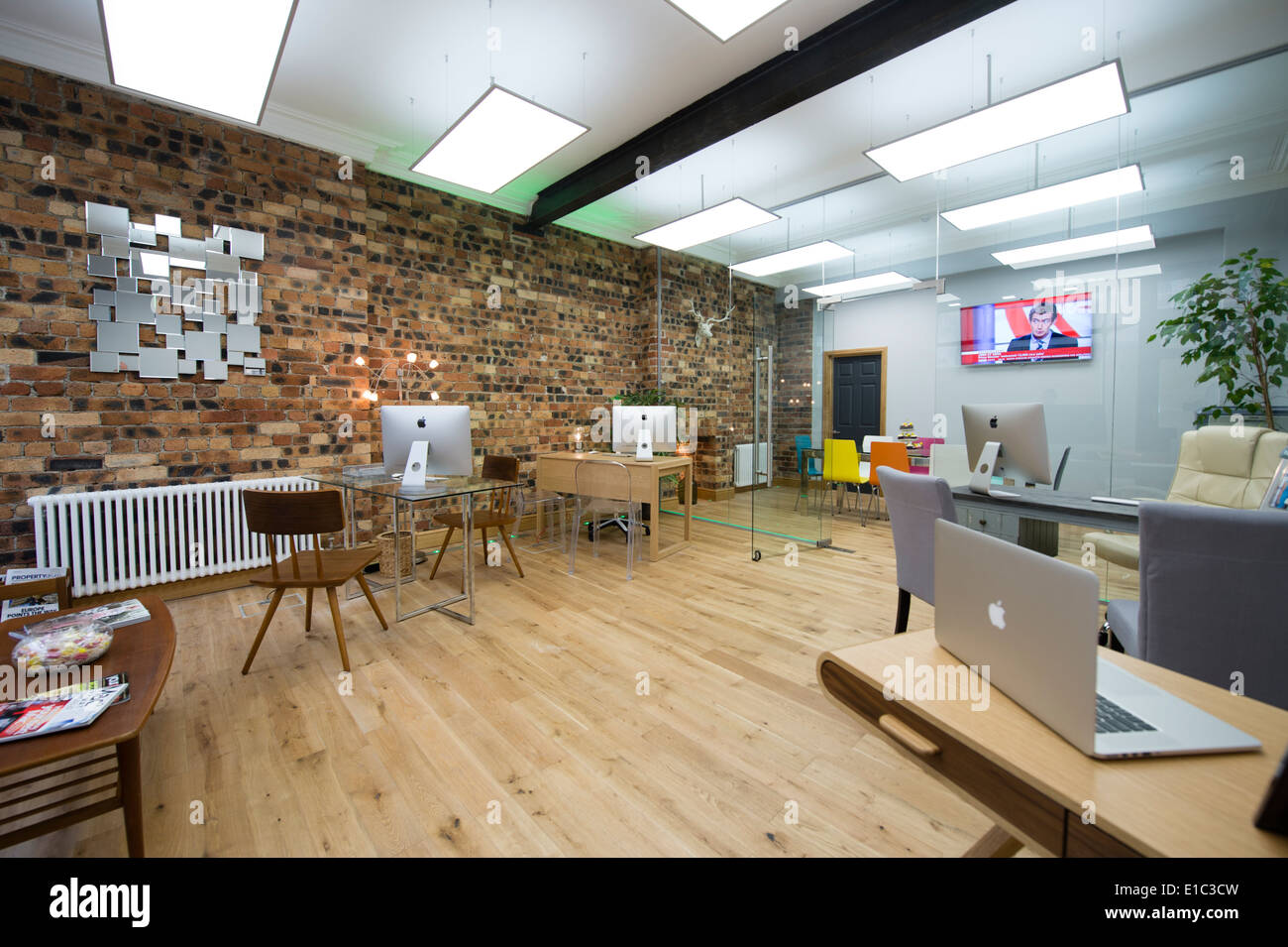 A Modern Clean Light Airy Open Plan Estate Agents Office Interior Bare Brick Wall UK