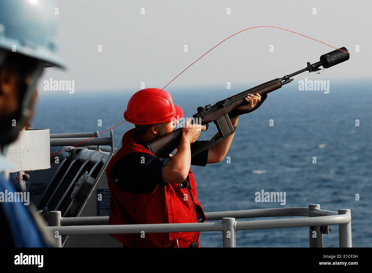 U.S. Navy Gunner's Mate 3rd Class Joshua A. Spooner prepares to ...