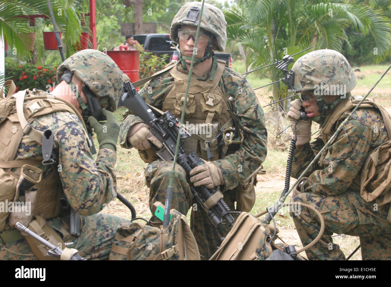 U.S. Marine Corps radio operators use communication gear during a ...