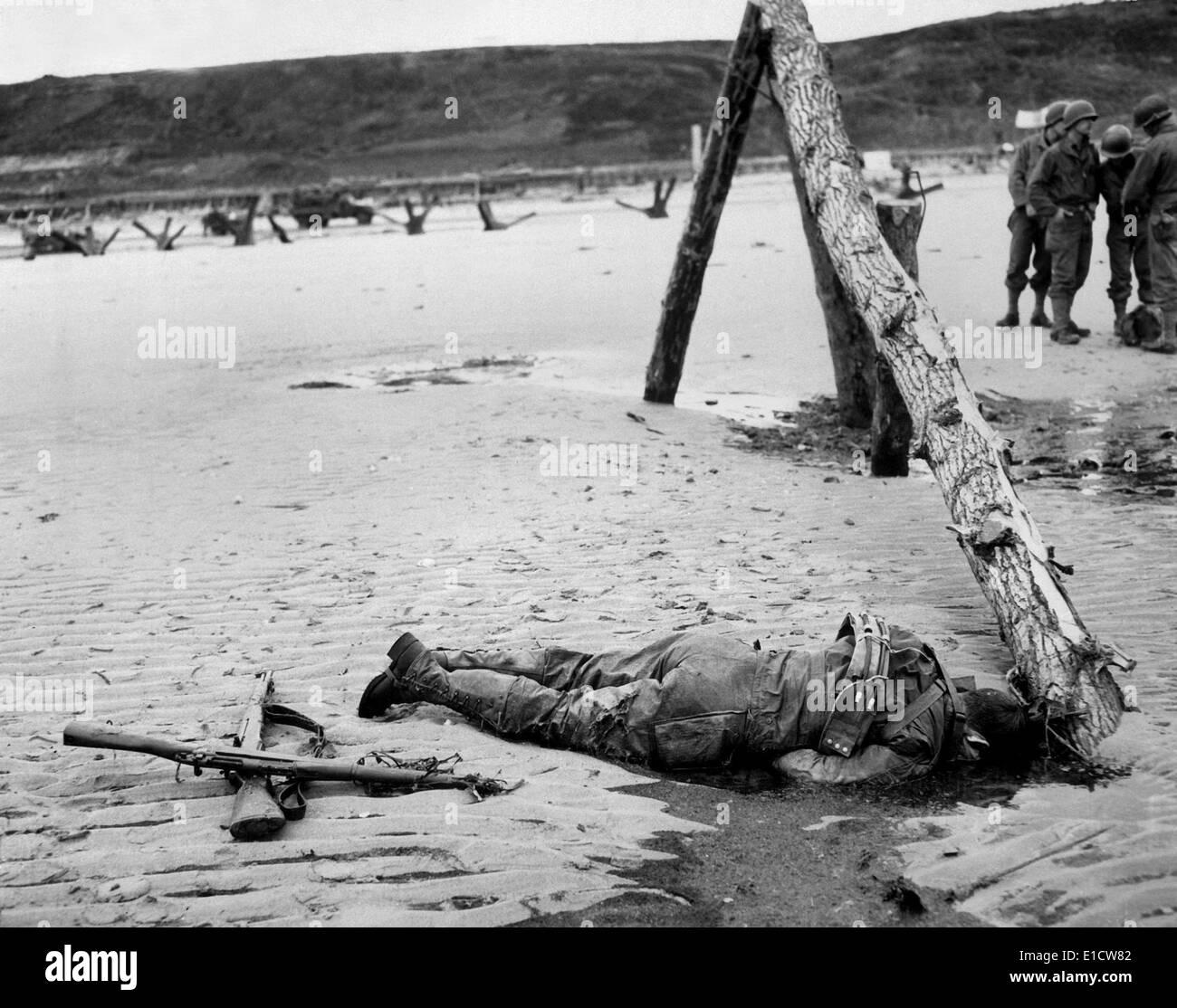 Dead U.S. soldier on Omaha beach on D-Day, June 6, 1944. Crossed ...