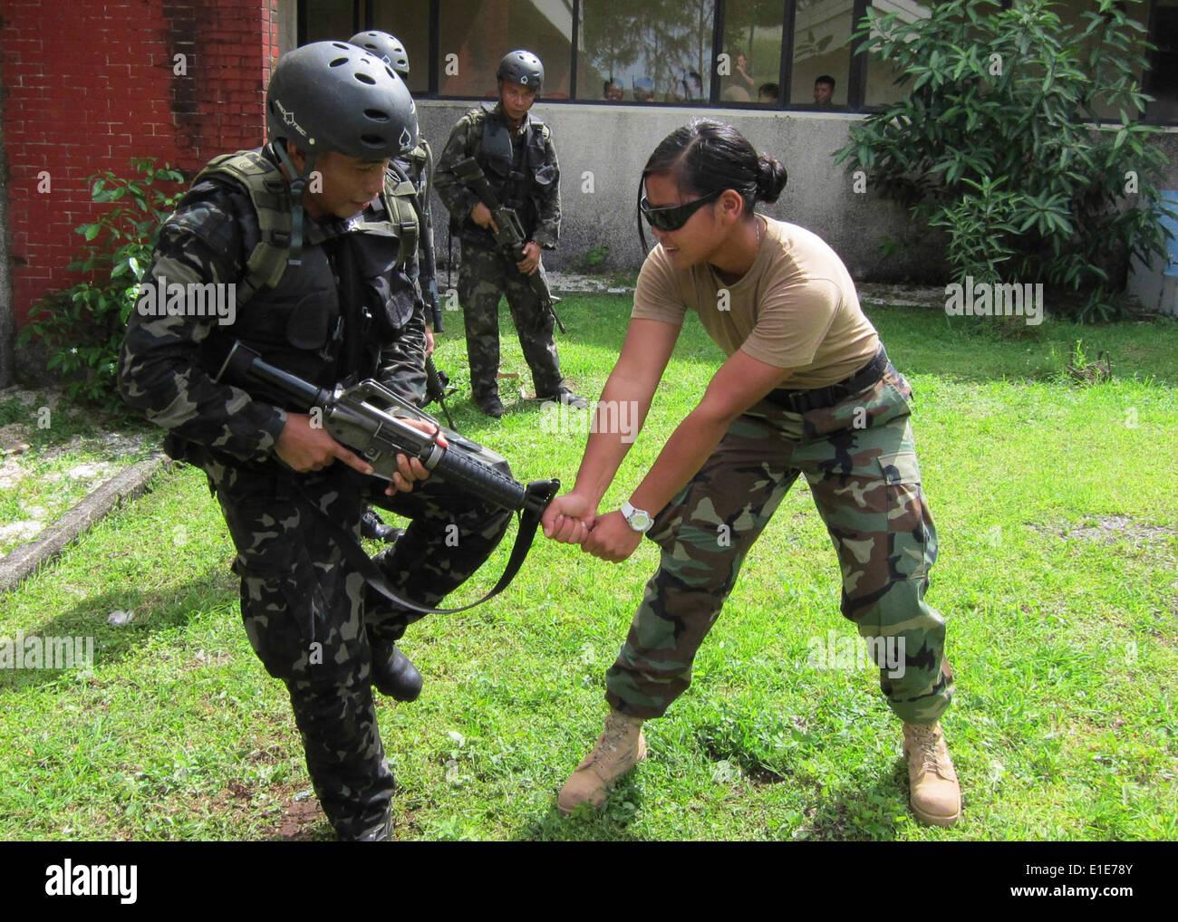 U.S. Navy Master-at-Arms 3rd Class Tanya Wedler demonstrates close ...