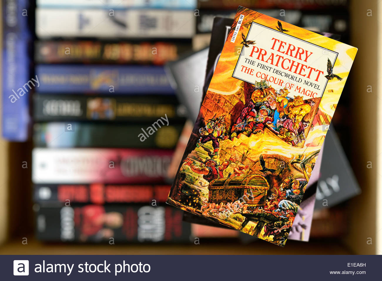 stock photo terry pratchett first discworld novel the colour of magic paperback title stacked used books england - The Color Of Magic Book