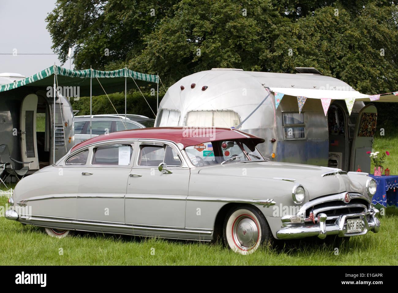 Hudson Hornet Parked beside a air stream trailer on a vintage ...