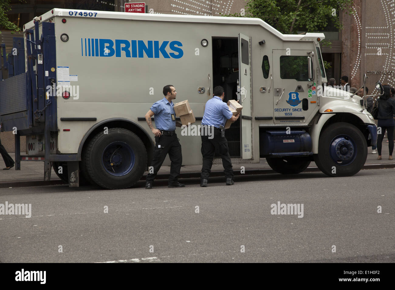 armored truck that picks up delivers valuables money outside of tiffany s in midtown manhattan