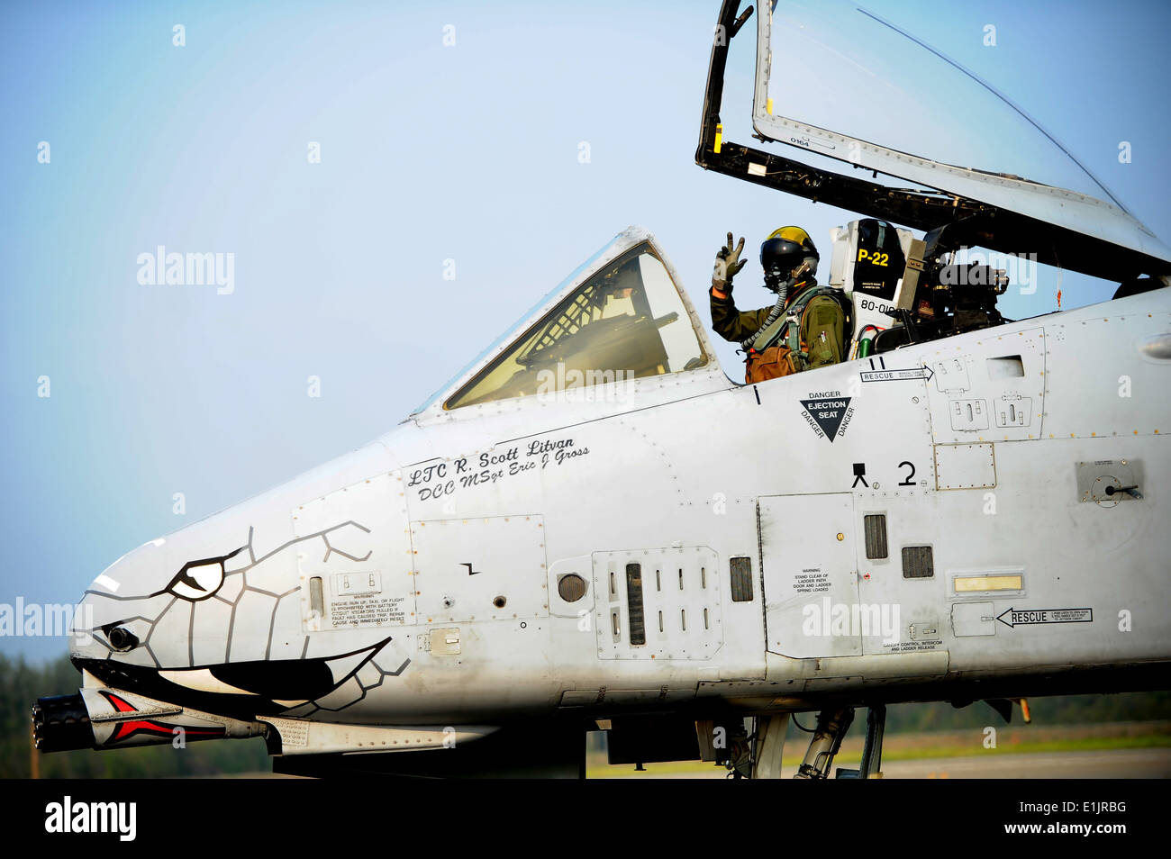 A U.S. Air Force A 10 Thunderbolt aircraft pilot assigned to the 163rd Fighter Squadron, Indiana Air National Guard waves as he