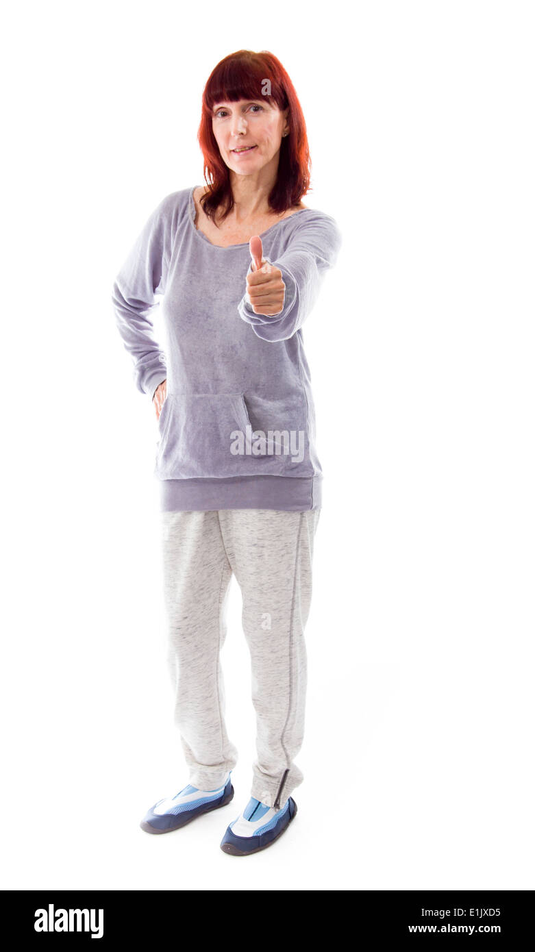 mature woman showing thumbs up sign stock photo, royalty free image