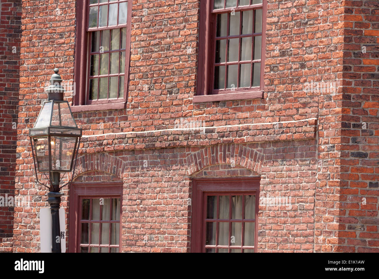 Colonial brick building and gas lamp an old restored for Colonial brick